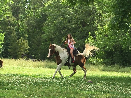 Aubrie riding an spoiled horse.